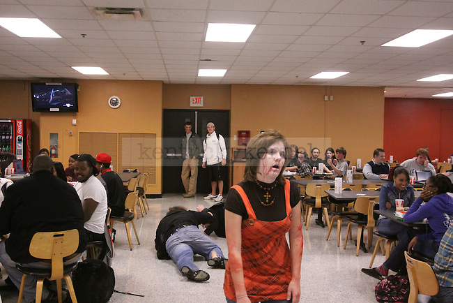 Theatre Sophomore Natalie Nicole walks around the Student Center Cafeteria as a zombie scaring and amusing UK students on Wednesday. Photo by Scott Hannigan | Staff