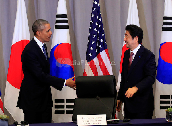 United States President Barack Obama attends a trilateral meeting with Prime Minister Shinzo Abe of Japan at the Nuclear Security Summit in Washington, DC on March 31, 2016. <br /> Credit: Dennis Brack / Pool via CNP/MediaPunch