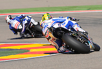 Jorge Lorenzo and Karel Abraham Taking a corkscrew duribg the Grand Prix Aragon 2012