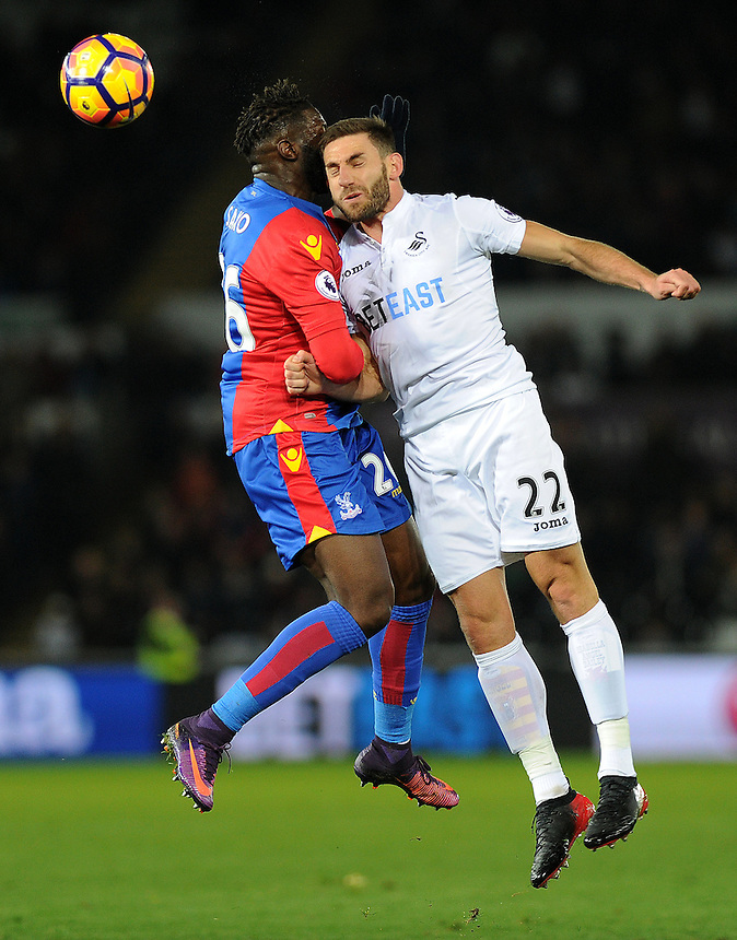 Crystal Palace's Bakary Sako battles with Swansea City's Angel Rangel<br /> <br /> Photographer Ashley Crowden/CameraSport<br /> <br /> The Premier League - Swansea City v Crystal Palace - Saturday 26th November 2016 - Liberty Stadium - Swansea <br /> <br /> World Copyright &copy; 2016 CameraSport. All rights reserved. 43 Linden Ave. Countesthorpe. Leicester. England. LE8 5PG - Tel: +44 (0) 116 277 4147 - admin@camerasport.com - www.camerasport.com
