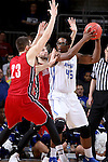 SIOUX FALLS, SD - MARCH 5:  Brent Calhoun #45 of Fort Wayne looks to pass against Tyler Flack #23 and another South Dakota defender in the 2016 Summit League Tournament. (Photo by Dave Eggen/Inertia)
