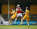 Gareth Taylor of Wrexham heads wide under pressure from Anthony Tonkin of Cambridge United (l) and Wayne Hatswell during the Blue Square Premier match between Cambridge United and Wrexham at the Abbey Stadium, Cambridge on 19th September, 2009..© Kevin Coleman 2009 .