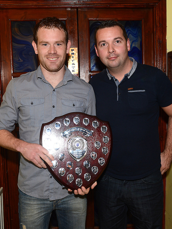 MDL Secretary Conor Lynch presents the Jack McGuinness plaque for player of the year to Paul Carrie at the Ardee Celtic awards night in Butterly's Bar. Photo:Colin Bell/pressphotos.ie