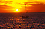 Silhouetted yacht against the setting sun,Tenerife, Canary Islands, Spain