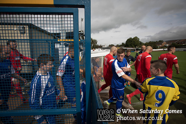 Clitheroe 0 Consett 1, 20/08/2016. Shawbridge, Northern Premier League Division One North. The players walking on to the pitch before Clitheroe (in blue) played Consett at Shawbridge in an FA Cup preliminary round tie. Northern Premier League division one north team Clitheroe were formed in 1877 and have played at the same ground since 1925. Visitors Consett, from the Northern League division one, won the match 1-0, watched by 207 spectators. Photo by Colin McPherson.