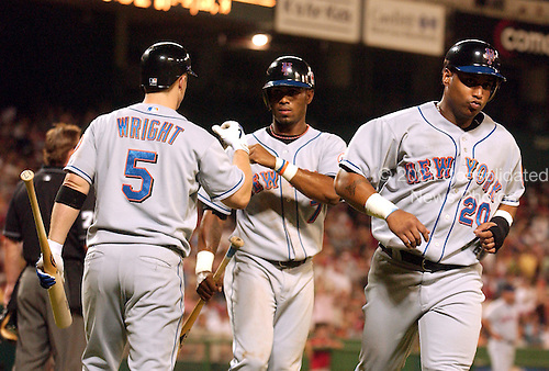 Washington, D.C. - September 23, 2005 -- New York Mets third baseman David Wright (5), left, congratulates shortstop Jose Reyes (7), center after he scored the second run in the sixth inning against the Washington Nationals at RFK Stadium in Washington, D.C. on September 23, 2005.  Reyes teammate, right fielder Victor Diaz (20), right, scored ahead of him on the play..Credit: Ron Sachs / CNP.(RESTRICTION: NO New York or New Jersey Newspapers or newspapers within a 75 mile radius of New York City)