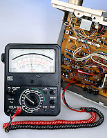 ANALOG MULTIMETER<br /> (Variations Available)<br /> Used as Voltmeter<br /> Testing voltage on stereo amplifier board. Reads approximately 62 volts.