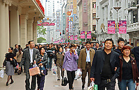 Shoppers crowd Nanjing Road, one of the biggest retailing streets in Shanghai. The street attracts hundreds of thousands of consumers and is home to many of the world's largest brand names..14 May 2006