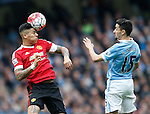 Marcos Rojo of Manchester United clears the ball under pressure from Jesus Navas of Manchester City during the Barclays Premier League match at The Etihad Stadium. Photo credit should read: Simon Bellis/Sportimage