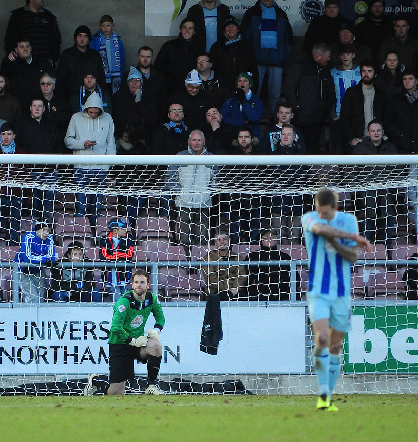Coventry City's Joe Murphy, left, and Coventry City's Carl Baker look dejected after Oldham Athletic's Jonson Clarke-Harris scored the opening goal <br /> <br /> Photo by Chris Vaughan/CameraSport<br /> <br /> Football - The Football League Sky Bet League One - Coventry City v Oldham Athletic - Sunday 29th December 2013 - Sixfields Stadium - Northampton<br /> <br /> &copy; CameraSport - 43 Linden Ave. Countesthorpe. Leicester. England. LE8 5PG - Tel: +44 (0) 116 277 4147 - admin@camerasport.com - www.camerasport.com