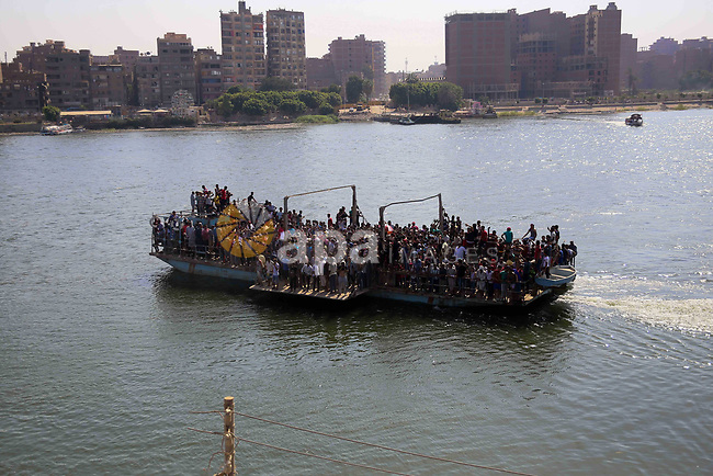 Egyptians ride a ship during the operations of removal of illegal buildings which built on the state lands  in the Warraq district of Giza, southwest of Cairo, Egypt, on July 16, 2017. Photo by Amr Sayed