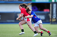 Kayleigh Powell of Wales is tackled by Agathe Souchat of France during the Women's Six Nations Championship Round 3 match between Wales and France at the Cardiff Arms Park in Cardiff, Wales, UK. Sunday 23 February 2020