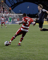 FC Dallas defender Jair Benitez (5) kicks a long pass down the field as New England Revolution forward Zack Schilawski (15) tries to intercept it in the air.  The New England Revolution drew FC Dallas 1-1, at Gillette Stadium on May 1, 2010