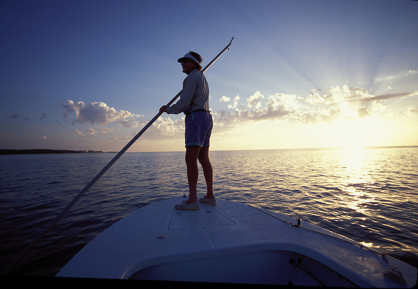 Richard Stanzyk poling his boat while Bonefish fishing in the Florida Keys at sunrise.