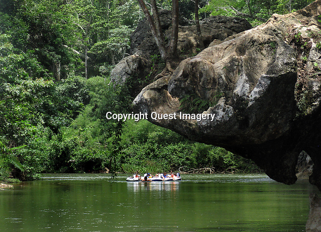 Cave Tubing at the Caves Branch, Nohoch Chi'en, National Park on the Sibun River in Belize.  Deep   into the rainforest of the Mayan Mountains in central Belize.  <br /> Photo by Mike Rynearson/Quest Imagery