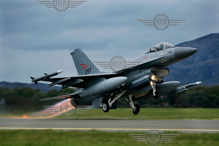 Lockheed Martin F-16 Fighting Falcon from Norwegian Air Force 338 squadron taking off with afterburner. BOLD AVENGER 2007 (BAR 07), a NATO  air exercise at Ørland Main Air Station, Norway. BAR 07 involved air forces from 13 NATO member nations: Belgium, Canada, the Czech Republic, France, Germany, Greece, Norway, Poland, Romania, Spain, Turkey, the United Kingdom and the United States of America. The exercise was designed to provide training for units in tactical air operations, involving over 100 aircraft, including combat, tanker and airborne early warning aircraft and about 1,450 personnel.