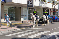 Local police on horseback patrol, Puerto Banus, Costa del Sol, Spain, 16th March 2019, 201903160520<br /><br />Copyright Image from Victor Patterson, Belfast, UK, BT9 5HG<br /><br />t: +44 28 9066 1296 <br />(from Rep of Ireland 048 9066 1296) <br />m: +44 7802 353836 <br />victorpattersonbelfast@gmail.com <br />www.victorpatterson.com<br /><br />Please see my Terms and Conditions of Use at https://www.victorpatterson.com/page2 <br /><br />It is IMPORTANT that you familiarise yourself with them.<br /><br />Images used on the Internet incur an additional cost and must be visibly watermarked i.e. © Victor Patterson within the body of the image and copyright metadata must not be deleted. Images used on the Internet have a size restriction of 4kbs and are chargeable at rates available at victorpatterson.com.<br /><br />This image is only available for the use of the download recipient i.e. television station, newspaper, magazine, book publisher, etc, and must not be passed on to any third party. It is also downloaded on condition that each and every usage is notified within 7 days to victorpattersonbelfast@gmail.com<br /><br />The right of Victor Patterson to be identified as the author is asserted in accordance with The Copyright Designs And Patents Act (1988). All moral rights are asserted.