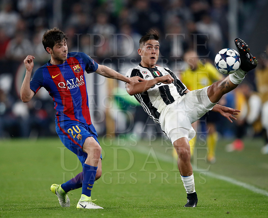 Football Soccer: UEFA Champions UEFA Champions League quarter final first leg Juventus-Barcellona, Juventus stadium, Turin, Italy, April 11, 2017. <br /> Juventus Paulo Dybala (r) in action with Barcellona's  Sergi Roberto (l) during the Uefa Champions League football match between Juventus and Barcelona at the Juventus stadium, on April 11 ,2017.<br /> UPDATE IMAGES PRESS/Isabella Bonotto