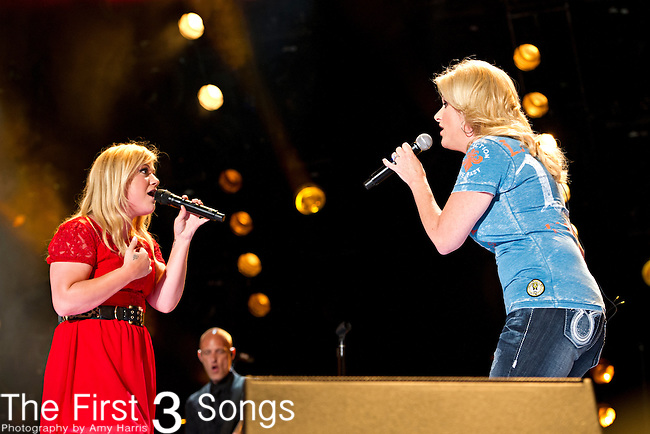 Trisha Yearwood performs with Kelly Clarkson at LP Field during Day 3 of the 2013 CMA Music Festival in Nashville, Tennessee.