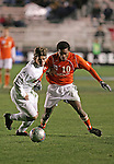 New Mexico's Lance Watson (l) and Clemson's Dane Richards (r). The University of New Mexico Lobos defeated the Clemson University Tigers 2-1 in a Men's College Cup Semifinal at SAS Stadium in Cary, NC, Friday, December 9, 2005.