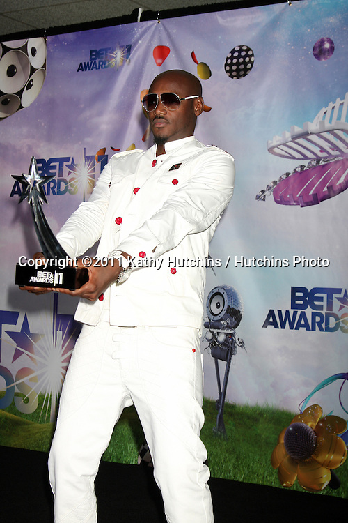 LOS ANGELES - JUN 26:  2Face Idibia in the Press Room at the 11th Annual BET Awards at Shrine Auditorium on June 26, 2004 in Los Angeles, CA