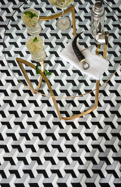 Francois, a waterjet mosaic shown in honed Chinese Black, honed Allure, and polished Dolomite, is part of the Illusions® collection by Sara Baldwin for New Ravenna.