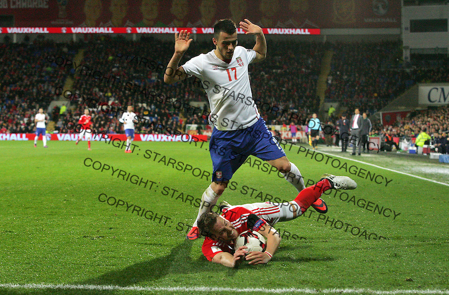 (copyright &amp; photo: STARSPORT)<br /> 12.11.16 World Cup Qualifier -  European Group D - Wales v Serbia -<br /> Filip Kostic of Serbia tackles Chris Gunter of Wales
