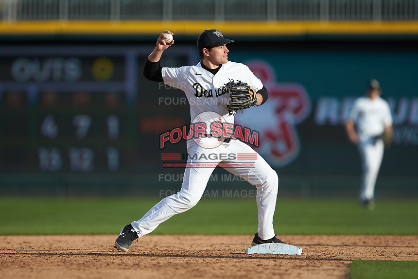Wake Forest Demon Deacons second baseman Chase Mascolo (28) turns a double play against the Furman Paladins at BB&T BallPark on March 2, 2019 in Charlotte, North Carolina. The Demon Deacons defeated the Paladins 13-7. (Brian Westerholt/Four Seam Images)