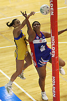 Jamilah Gupwell beats Vilimaina Davu to the ball during the ANZ Netball Championship match between the Central Pulse and Northern Mystics, TSB Bank Arena, Wellington, New Zealand on Monday, 4 May 2009. Photo: Dave Lintott / lintottphoto.co.nz