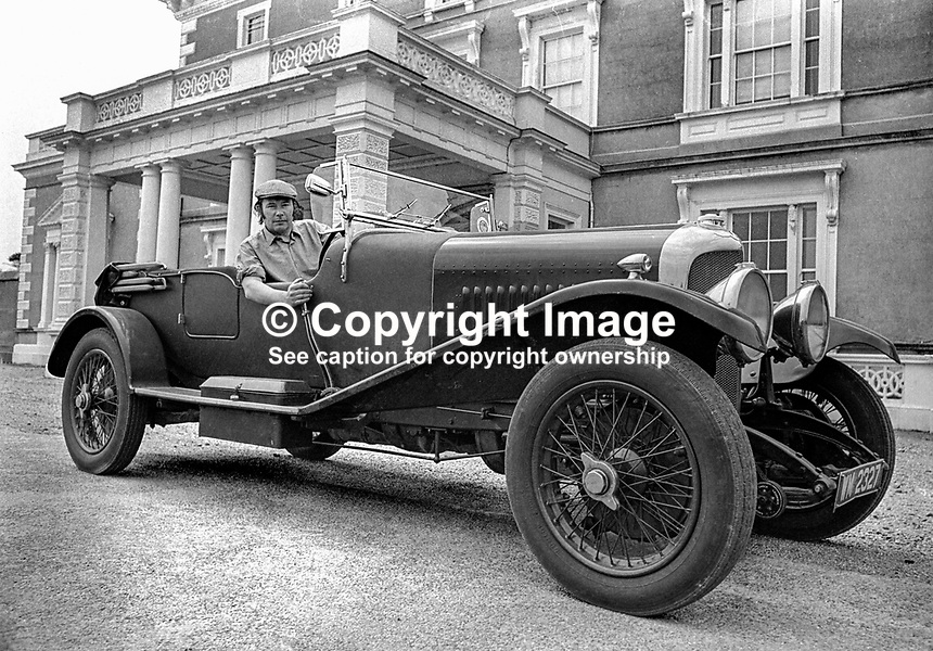 Henry Mulholland, 4th Lord Dunleath, Ballywalter, Co Down, N Ireland, at the wheel of an open-top Bentley in front of Ballywalter Park Mansion House. 197507000569b.<br />