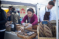The Pain D'Avignon booth at the Smorgasburg in East River State Park in the Williamsburg neighborhood of Brooklyn in New York on Saturday, April 6, 2013. The marketplace features prepared and artisanal foods made in Brooklyn by small entrepreneurs. In the two years the market has been in operation it has provided a venue for numerous chefs and cooks to sell their wares, some of whom have grown into large successful businesses. (© Frances M. Roberts)