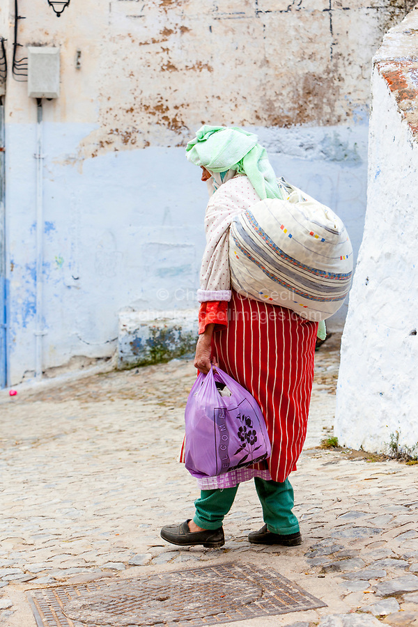 Chefchaouen, Morocco.  Old Woman in Traditional Berber Dress of the Rif Region, Northern Morocco.