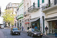 in the San Telmo district around Plaza Dorrego Square, a row of old houses in Art Nouveau Jugend style around the square, all now housing antique shops., people walking on the street. Calle Defensa Defence street Buenos Aires Argentina, South America