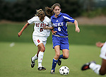 Tami Krzeszewski (5), of NC State, challenges Duke's Kelly Hathorn (6) for the ball on Sunday October 2nd, 2005 at SAS Stadium in Cary, North Carolina. The Duke University Blue Devils defeated the North Carolina State University Wolfpack 1-0 during an Atlantic Coast Conference women's soccer game.