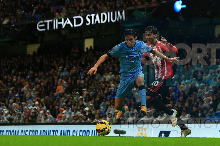 Ricky Alvarez of Sunderland and Jesus Navas of Manchester City - Manchester City vs. Sunderland - Barclay's Premier League - Etihad Stadium - Manchester - 28/12/2014 Pic Philip Oldham/Sportimage