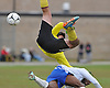 Ward Melville goalie Peter Jespersen, top, keeps the ball out of the net despite being upended by North Babylon No. 11 Tyler Rodriguez during the second half of a Suffolk County varsity boys' soccer Class AA first round playoff game at North Babylon High School on Tuesday, October 27, 2015. Rodriguez was assessed a yellow card after the collision. Ward Melville won by a score of 1-0.<br /> <br /> James Escher
