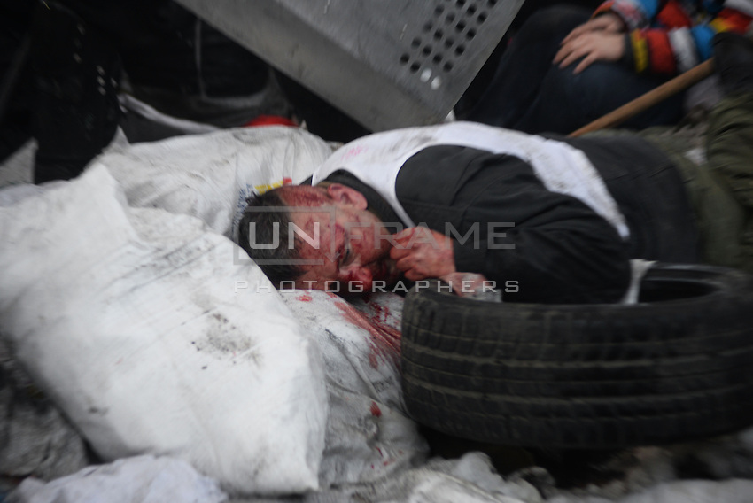 An injured protester fell into the barricades.  Kiev, Ukraine
