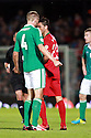 SERIES OF THREE IMAGES  (Head Butting Picture) Northern Ireland's Gareth McAuley confronts Portugal's  Helder Postiga, resulting in Postiga head butting McAuley and getting a red card and being sent off during the first half a World Cup Qualifier in Belfast, Friday September 6th, 2013.  Photo/Paul McErlane