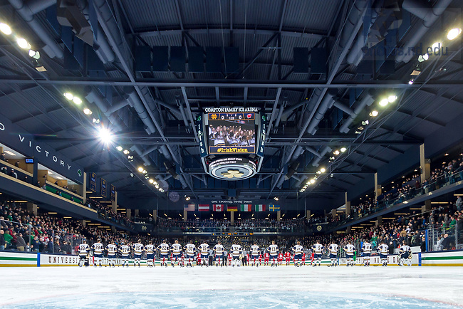 January 19, 2018; Players stand for the national anthem at a hockey game. (Photo by Matt Cashore/University of Notre Dame)
