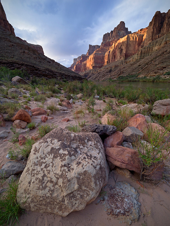 Light and shadows dance across the cliffs near Above LCR camp at river mile 62, near the confluence of the Colorado and Little Colorado River in the Grand Canyon National Park, Arizona, USA