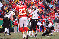 Jacksonville Jaguars kicker Josh Scobee and holder Chris Hanson watch as the ball goes through the uprights for a 33 yard field goal during the second quarter at Arrowhead Stadium in Kansas City, Missouri on December 31, 2006. The Chiefs won 35-30.