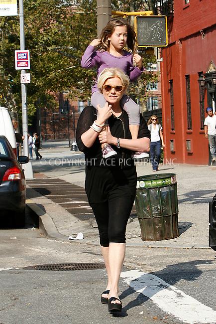 WWW.ACEPIXS.COM . . . . .  ....September 23, 2010....Deborra-Lee Furness, wife of actor Hugh Jackman, and her daughter walk through Soho on September 23, 2010 in New York City.......Please byline: NANCY RIVERA - ACEPIXS.COM.... *** ***..Ace Pictures, Inc:  ..Philip Vaughan  (646) 769 0430..e-mail: info@acepixs.com..web: http://www.acepixs.com