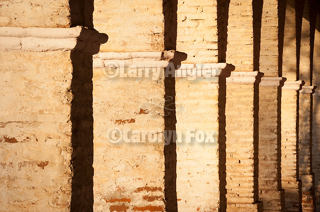 Adobe pillars of the front colonnade, Mission San Antonio de Padua, California.