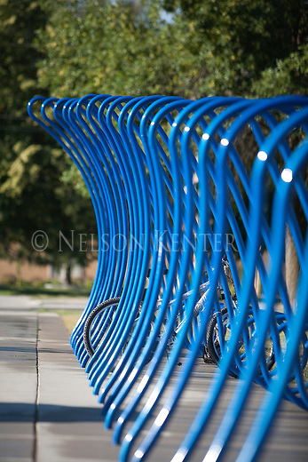 Artistic bike rack in Missoula, Montana is designed to look like a water wave - its is located at Splash Montana Water Park