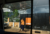 An employee near the Orange.ug headquaters, Clement Hill Road, Kampala. Orange entered the market in March 2009, as the fifth network provider.