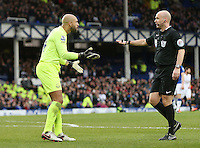 Tim Howard appeals to Referee Mr Anthony Taylor after a penalty is awarded against him for a foul on Andre Ayew during the Barclays Premier League match between Everton and Swansea City played at Goodison Park, Liverpool
