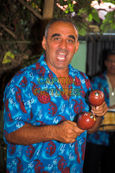 Man singing and playing maracas, Casa de la Trova, location for traditional Cuban music, Bayamo, Granma Province, Cuba