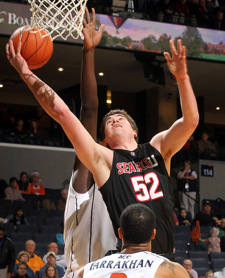 Dec. 22, 2010; Charlottesville, VA, USA; Seattle Redhawks forward Alex Jones (52) shoots in front of Virginia Cavaliers center Assane Sene (5) during the game at the John Paul Jones Arena. Mandatory Credit: Andrew Shurtleff