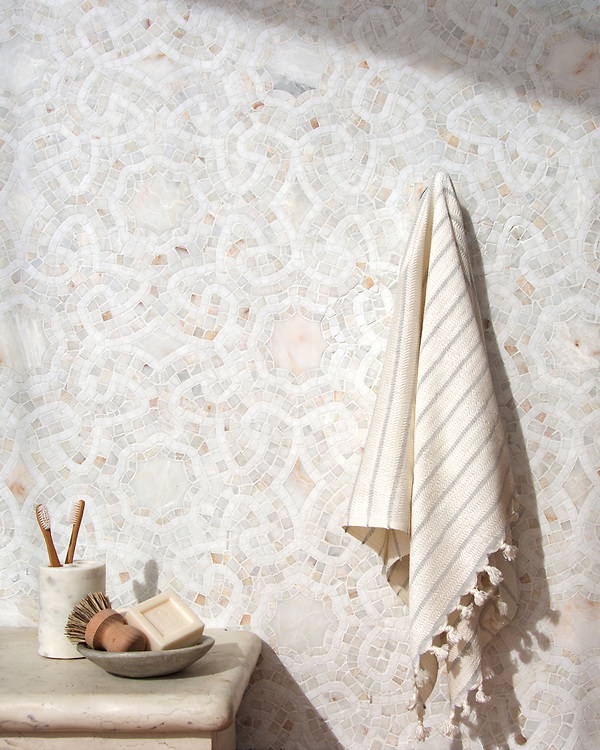 Juliana, a stone waterjet and hand-cut stone mosaic, shown in honed and hand-chopped tumbled Heavenly Cream and hand-chopped tumbled Thassos, is part of the Miraflores collection by Paul Schatz and Sara Baldwin for New Ravenna.