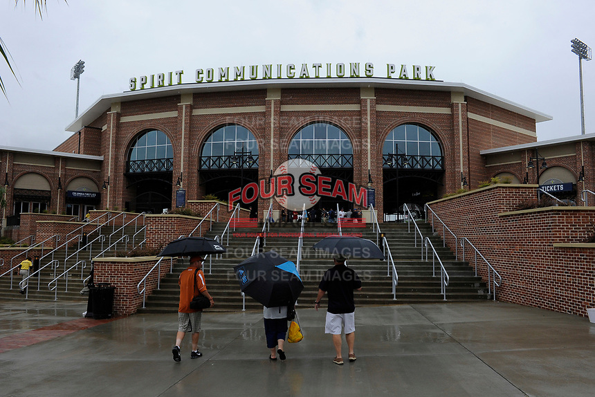 Fans arrive in the rain at the South Atlantic League All-Star Game Fan Fest on Tuesday, June 20, 2017, at Spirit Communications Park in Columbia, South Carolina. The game was suspended due to rain after seven innings tied, 3-3. (Tom Priddy/Four Seam Images)
